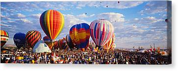 Balloons Being Launched Canvas Print by Panoramic Images