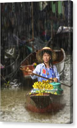 Canvas Print featuring the photograph Banana Vendor In The Rain by Rob Tullis