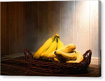 Bananas Canvas Print by Olivier Le Queinec