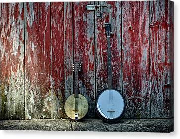 Banjos Against A Barn Door Canvas Print by Bill Cannon