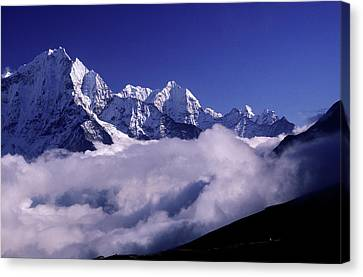Bank Of Heavy Clouds Rolls Up The Gokyo Canvas Print by Paul Dymond