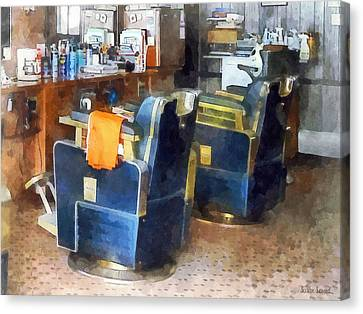 Barberchairs Canvas Print - Barber Chair With Orange Barber Cape by Susan Savad