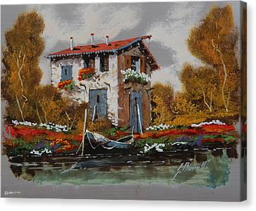 Barca Al Molo Canvas Print by Guido Borelli