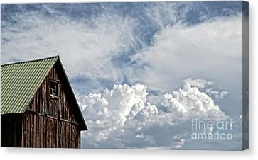 Canvas Print featuring the photograph Barn And Clouds by Joseph J Stevens