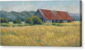 Barn In The Field Canvas Print by Lucie Bilodeau