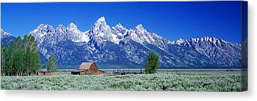 Barn On Plain Before Mountains, Grand Canvas Print by Panoramic Images