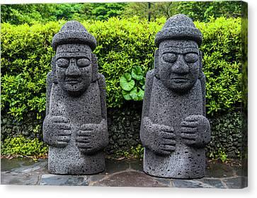 Basalt Statues In Seogwipo Canvas Print by Michael Runkel