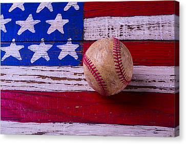 Baseball On American Flag Canvas Print by Garry Gay