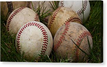 Baseballs On The Grass Canvas Print by David Patterson