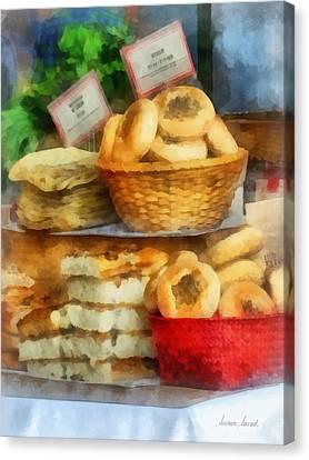Basket Of Bialys Canvas Print by Susan Savad