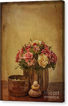 Basket Of Spring Roses Canvas Print by Terry Rowe