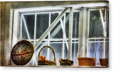 Baskets In The Window Canvas Print by Joan Bertucci
