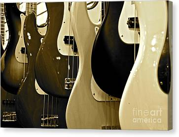 Bass Guitars  Canvas Print by Sarah Mullin