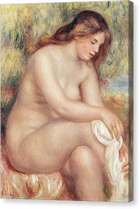 Bather Drying Herself Canvas Print by Pierre Auguste Renoir