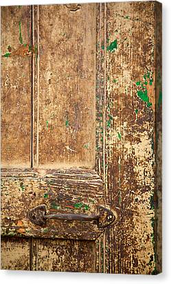 Battered Door Canvas Print by Peter Tellone