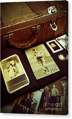 Battered Suitcase Of Antique Photographs Canvas Print by Amy Cicconi