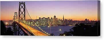 Bay Bridge At Night, San Francisco Canvas Print by Panoramic Images