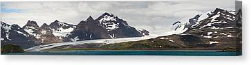 Bay In Front Of Snow Covered Mountains Canvas Print by Panoramic Images