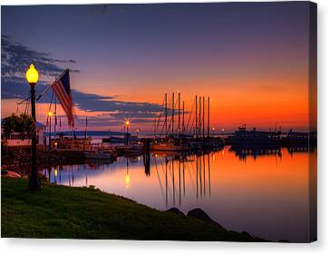 Sail Boats Canvas Print - Bayfield Wisconsin Fire In The Sky Over The Harbor by Wayne Moran