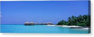 Beach Cabanas, Baros, Maldives Canvas Print by Panoramic Images