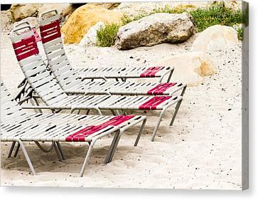 Beach Chairs Canvas Print by Bernard  Barcos