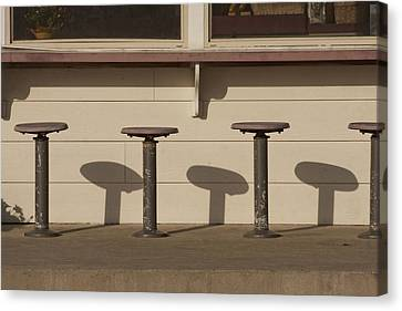 Beach Diner Stools Canvas Print by Art Block Collections