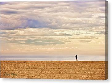 Beach Jogger Canvas Print by Chuck Staley