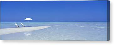 Empty Chairs Canvas Print - Beach Scene Digufinolhu Maldives by Panoramic Images