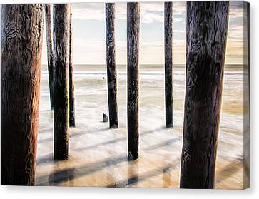 Beach Totems Canvas Print by Steve Stanger