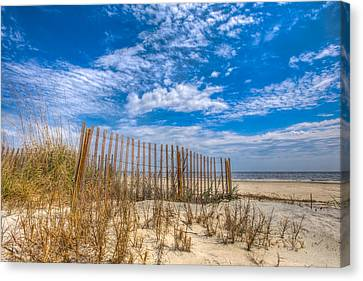 Beach Under Blue Skies Canvas Print by Debra and Dave Vanderlaan