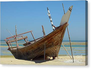 Beached Dhow At Wakrah Canvas Print by Paul Cowan