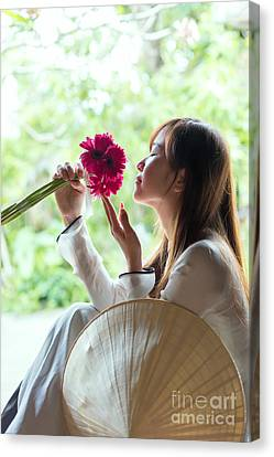 Beautiful Asian Woman With Flowers - Vietnam Canvas Print by Matteo Colombo