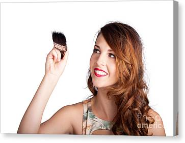 Beautiful Woman Holding Paintbrush Over White Canvas Print
