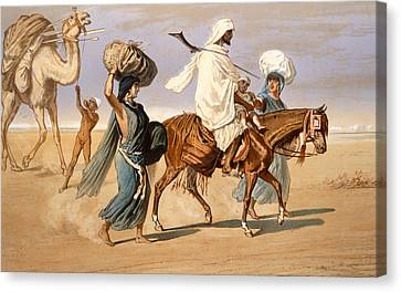 Bedouin Family Travels Across The Desert Canvas Print by Henri de Montaut