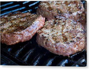 Beef Quarterpounder Burgers Begin To Cook On The Gas Barbecue Canvas Print by Fizzy Image