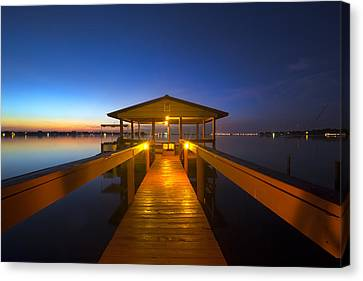 Before Dawn At The Dock Canvas Print by Debra and Dave Vanderlaan