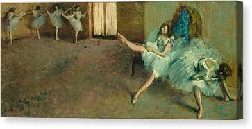 Before The Ballet Canvas Print by Edgar Degas