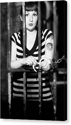 Canvas Print featuring the photograph Behind Bars by Jim Poulos