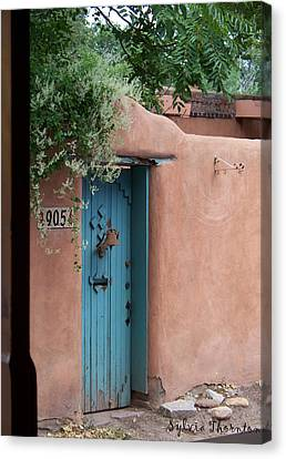 Canvas Print featuring the photograph Behind The Blue Door by Sylvia Thornton
