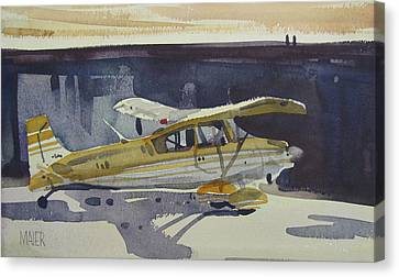 Behind The Hanger Canvas Print by Donald Maier