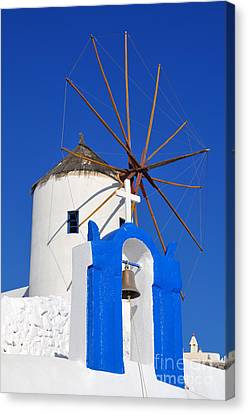 Belfry And Windmill In Oia Town Canvas Print by George Atsametakis