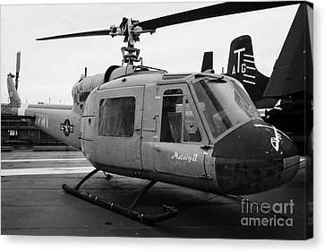Bell Uh 1a Uh1 Uh1a 1 Huey On Display On The Flight Deck At The Intrepid Sea Air Space Museum Canvas Print by Joe Fox