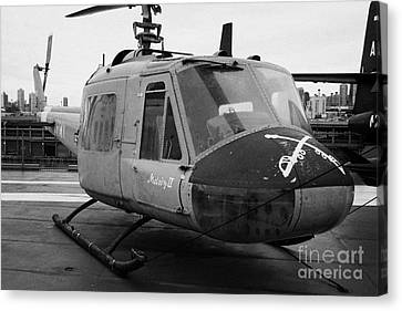Bell Uh 1a Uh1 Uh1a Huey On Display On The Flight Deck At The Intrepid Sea Air Space Museum Canvas Print by Joe Fox