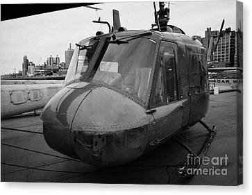 Bell Uh1 Huey On Display On The Flight Deck Of The Uss Intrepid At The Intrepid Sea Air Space Museu Canvas Print by Joe Fox