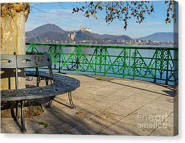 Bench And Castle Canvas Print by Mats Silvan