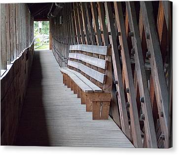 Bench Inside A Covered Bridge Canvas Print by Catherine Gagne