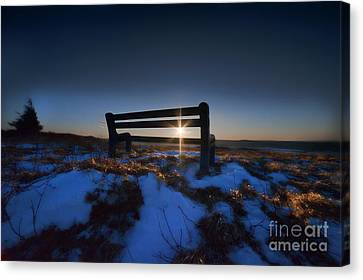Bench On Top Of Mountain At Sunset Canvas Print by Dan Friend