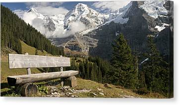 Bench With Mt Eiger And Mt Monch Canvas Print by Panoramic Images