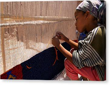 Berber Girl Working On Traditional Berber Rug Ait Benhaddou Southern Morocco Canvas Print by Ralph A  Ledergerber-Photography