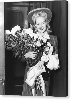 Betty Grable With Flowers Canvas Print by Underwood Archives